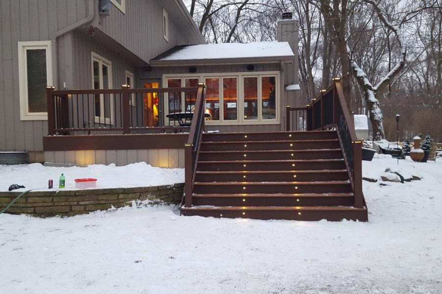 Trex® Tiki Torch Deck with Vintage Lantern Railings & Stair Riser Lights Crystal Lake