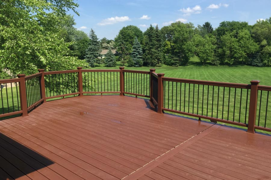 Fire Pit Trex® Deck with Black Balusters Inverness