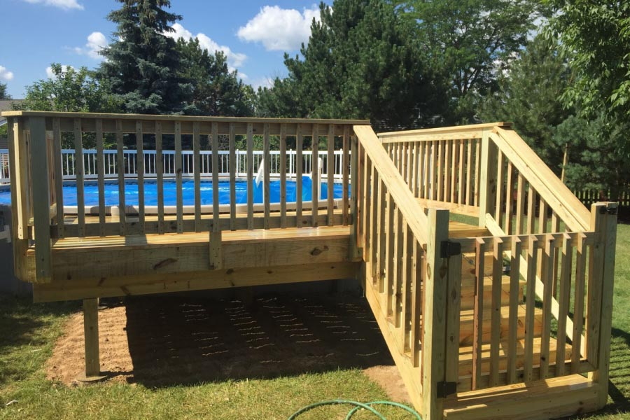 Wooden pool deck wooden designs for Above ground pool gate ideas