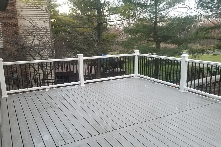 Gravel Path Trex® Deck with White Railing and Aluminum Balusters
