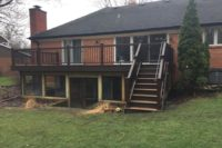 Havana Gold Trex® Deck with Vintage Lantern Railings & Under Deck Screen Room Inverness