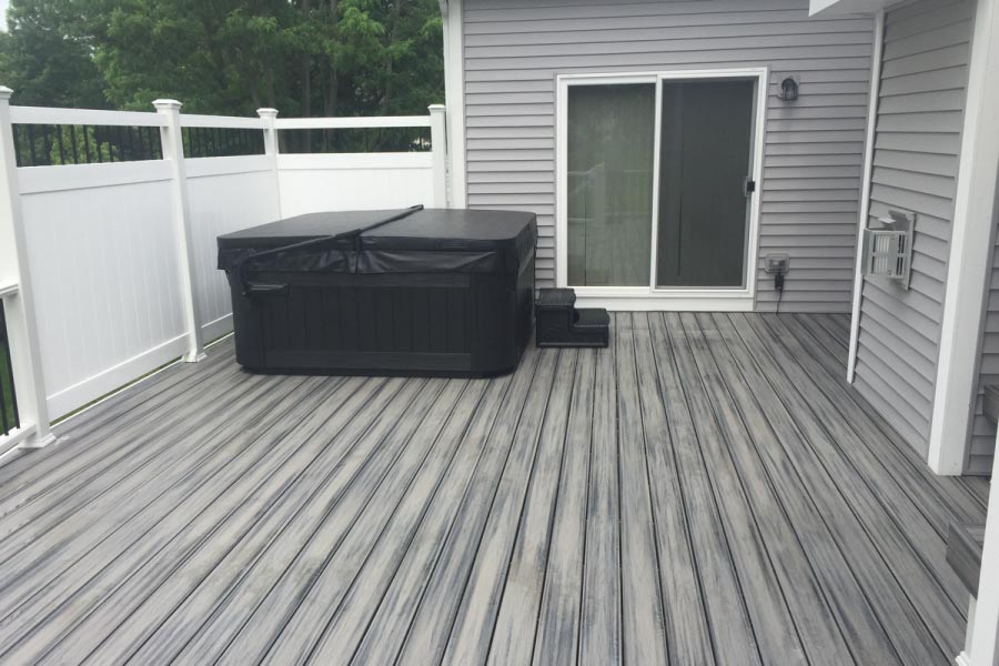 Island Mist Trex® Deck with Privacy Wall Around Hot Tub Cary