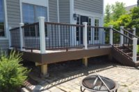 Spiced Rum & Vintage Lantern Trex® Deck with White Posts Lakewood