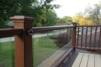 Trex® Deck Balcony with Glass Railings and Post Lighting McHenry County