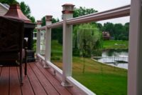 Trex® Deck with Glass Railings and Copper Solar Post Caps Antioch