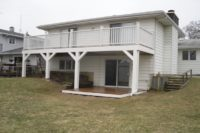 Trex® Deck with White Railings, Posts and Ground Level Trex® Deck Lake County