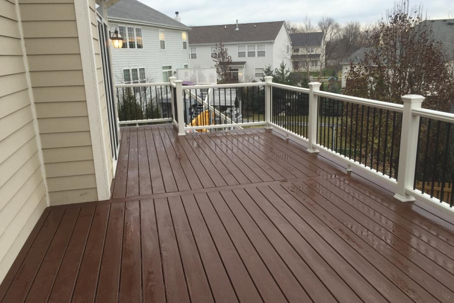 Trex® Fire Pit Deck with White Railings and Black Aluminum Balusters Lake County