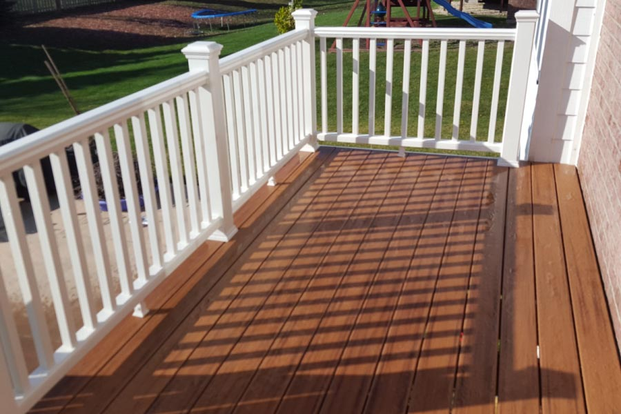 Trex® Tiki Torch Deck with White Railings Barrington
