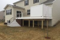 Vintage Lantern Trex® Deck with White Flared Stairs & Privacy Wall Lakemoor
